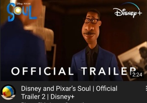 """A screenshot of the Soul trailer -  an animated man wearing a sweater and a blazer. Below him are the words """"Official Trailer""""."""