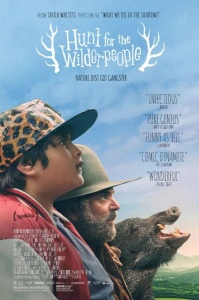 The poster image for the movie. A preteen boy in a hat and red and white jacket, then an older man witha beard and a hat and then a boar all facing to the right with the title of the movie above them.